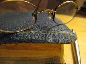 Glasses On Old Book by Jim Mahoney
